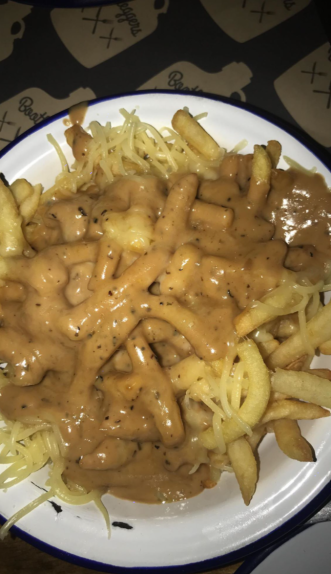 Chips Covered in Pepper Sauce Topped with Cheese